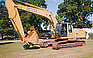 Show the detailed information for this 2003 JOHN DEERE 230CLC TRACKHOE.