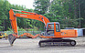 Show the detailed information for this 2004 HITACHI ZX200LC.